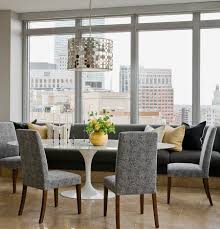 charming upholstered banquette seating and table with dining chairs also pendant lighting