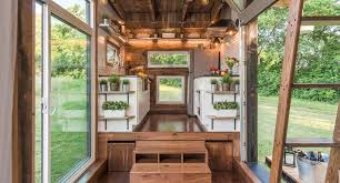 tiny house movement. well lit open area in this beautiful tiny house. house movement o