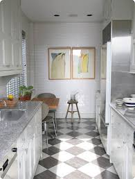 Black White Checkered Laminate Flooring With Kitchen Cabinet And Chair And  Brick Walls