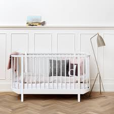 scandinavian nursery furniture. White Curved Cotbed With Spindles In Modern Nursery Styled Cushions And A Baby Blanket Scandinavian Furniture
