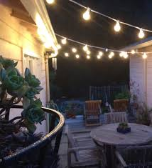 lights lamps string chairs table flower wall wood plants