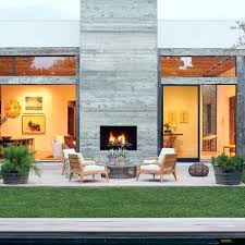 indoor outdoor fireplace warming up the backyard patio by double sided cost indoor outdoor fireplace s security