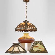 arts and crafts slag glass chandelier with metal overlay and three lamp shades shades two slag glass with patinated metal overlay and one chipped glass