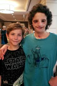 photo nathaniel newman is pictured with actor jacob tremblay who portrays a kid born