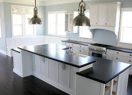 white shaker kitchen cabinets with brown granite countertops