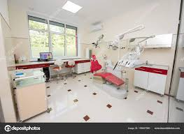 dental office colors. Dental Clinic With Modern Units, Chairs, Equipment, Tools And Microscope Used By Dentists. Office In Red White Colors. Colors