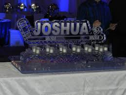 his ice hockey theme was new york rangers so this worked perfectly i also designed the table centerpieces which also were all ice sculptures candle lighting ideas
