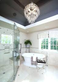 chandelier over bathtub master bathroom with glass above cornered and modern vanity cabin chandelier over bathtub