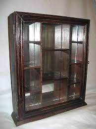 wall display case with glass doors nib wood curio display cabinet glass door mirrored back wall mount in cabinets with doors remodel glass wall display case