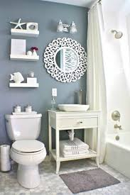 Vintage Look Small And Narrow Bathroom Spaces With Beach Inspired Theme And  DIY Wooden Vanity With Towel Rack And Storage Under Round Mirror And Beach  ...