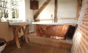 copper bathtub with a raw look