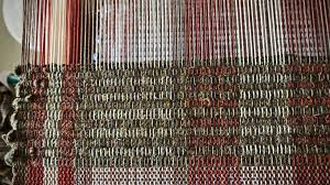 spaced rep rag rug with wool fabric strips