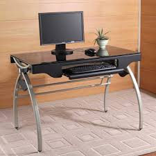 this metal and glass style computer desk features a tempered black glass top arched leg base design keyboard tray and pencil drawer