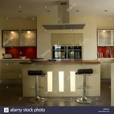breakfast bar lighting ideas. Bar Stools At Central Island Breakfast In Modern Kitchen With Interior Lighting Wall Cupboards Ideas A
