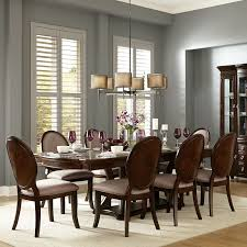 Complete your dining space with this striking Verdiana Rich Brown Cherry  Finish Extending Dining Set.