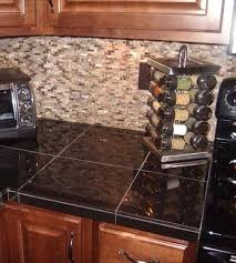 granite tile but with black grout countertops glass backsplash para