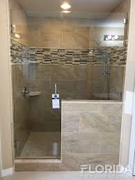 frameless inline door secured with glass clamps and brushed nickel hardware finish