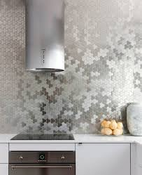 Kitchen Design Idea - Stainless Steel Backsplash // Stainless steel tiles  cover the back wall