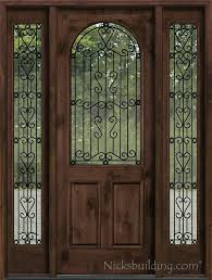 iron and glass doors wrought iron is between clear glass wrought iron vs stained glass door