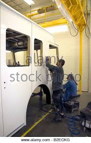 chassis stock photos chassis stock images alamy worker using a power sander at spartan motors a truck chassis manufacturer in charlotte michigan