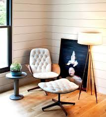 classic vintage room design with vinyl siding and wooden floor and glass window and painting and comfortable white unique bench idea of cozy reading chair
