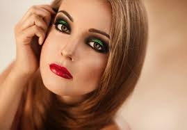 beautiful model with bright colorful makeup red lips and beautiful hair looking straight
