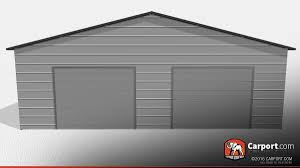double wide garage building with grey walls two garage doors and black trim