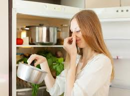 Ventilation is crucial to removing unpleasant smell. When you are cooking,  close your door of the kitchen and open the windows.