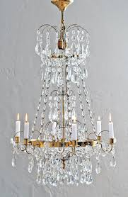 chandelier at the showroom of horsch antiques and interior design germany image source here