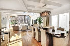 rectangle dining room chandelier over wooden dining table and beige fabric covered dining chairs also
