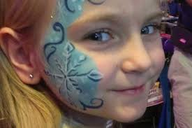 face painter intricate snow flake design kid s party
