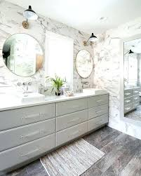 oversized bath mat a gray framed full length bathroom mirror mounted on marble wall tiles reflects oversized bath mat