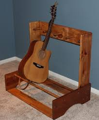 i made this guitar stand designed for 4 guitars in case i get another one