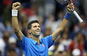 novak djokovic of serbia celebrates after defeating kyle edmund of britain during a men s singles fourth round match at the 2016 u s open in new york