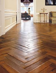 if you can t swing the wood floors you can also try installing wood tiles in a smaller space like muudroom or bathroom to get a hint of the look