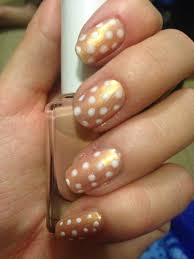 Shiny nude with white polka dots nail art. I used the tip of a ...