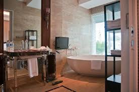 hotel indonesia kempinski suite bathroom with a view