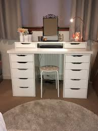 the drawers are all from ikea they are the alex range that they have and were all bought seperate the 2 sets of drawers were 50 each the table top was