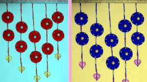 how to make decorative wall hangings with paper and waste cloth handmade wall hanging ideas