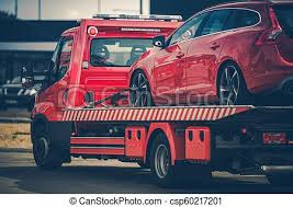 Broken car on a towing truck. Red broken car on a red towing truck ...