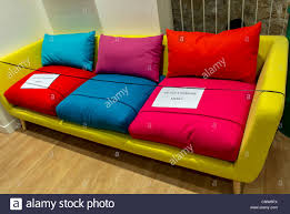 colorful furniture. Paris, France, Colorful Sofas On Display In Household Furniture Shop, The Marais District,