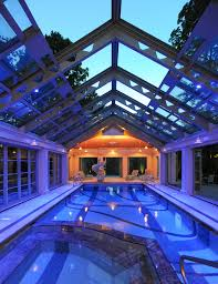 pool enclosure lighting. contemporary enclosure clear glass pool enclosure with glowing blue and low lighted yellow lighting  fixtures and pool enclosure lighting g