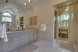 the light filled master bath features dual sinks a separate soaking tub and shower ample shower lighting