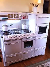 1951 Aristocrat by Okeefe and Merritt: three ovens, warming draw, separate  broiler,