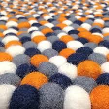black and orange rug gray rugs felt ball in navy grey white round pertaining to plan black and orange rug