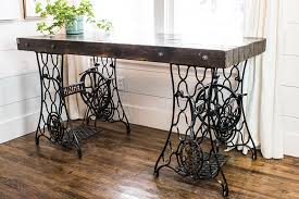 an industrial desk made from two antique singer sewing machine treadle bases
