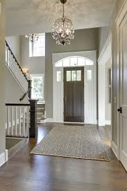 front foyer lighting gorgeous entryway with high ceilings tall front door dark wood small foyer table