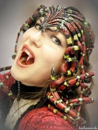 a medusa headpiece with colorful snakes