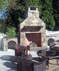 we replaced an aging hot tub with this magnificent fieldstone fireplace and accompanying wood storage areas the fireplace is dual fuel capable natural gas