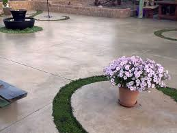 artistic concrete patio with curly cutouts